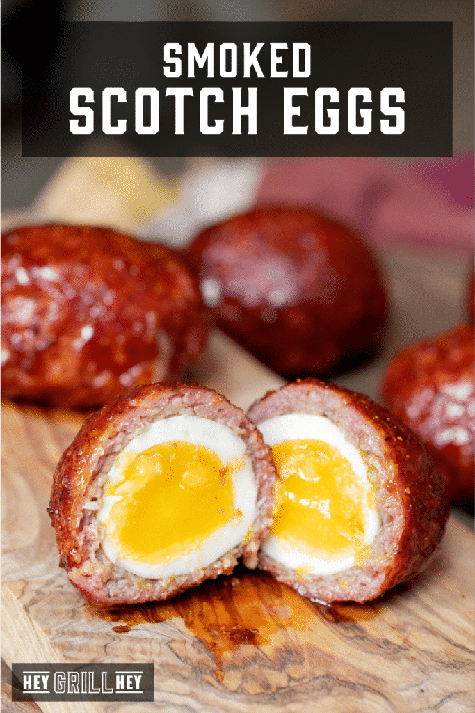 Cross-section of a sliced smoked scotch egg. Text overlay reads: Smoked Scotch Eggs.