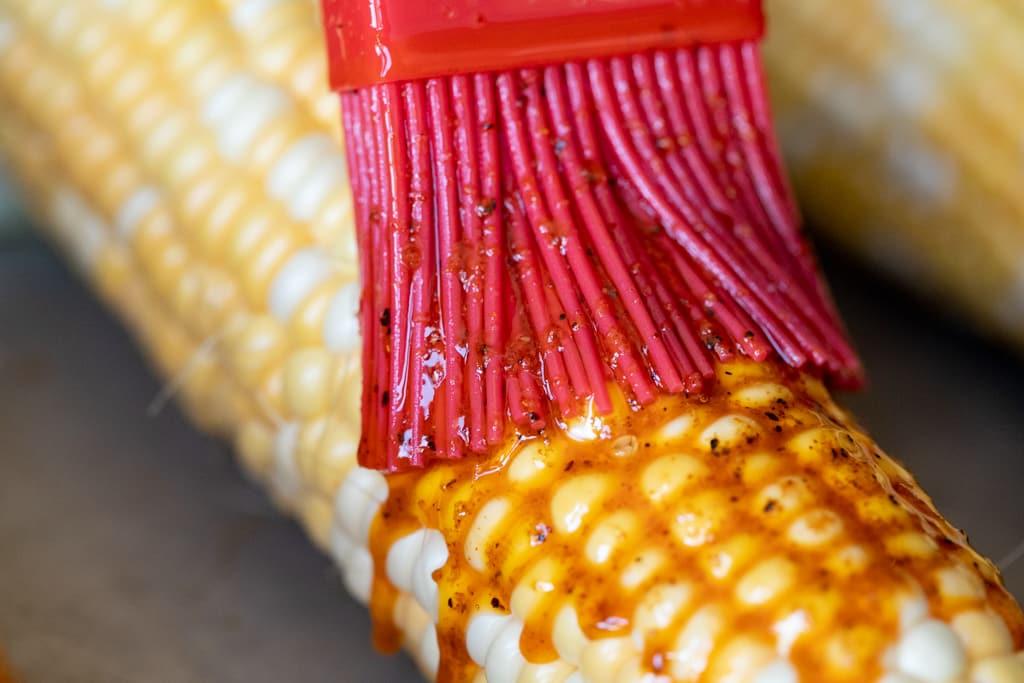 BBQ rub-seasoned butter being based on an ear of corn.