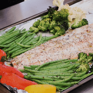 Grilled salmon and vegetables on a sheet pan.